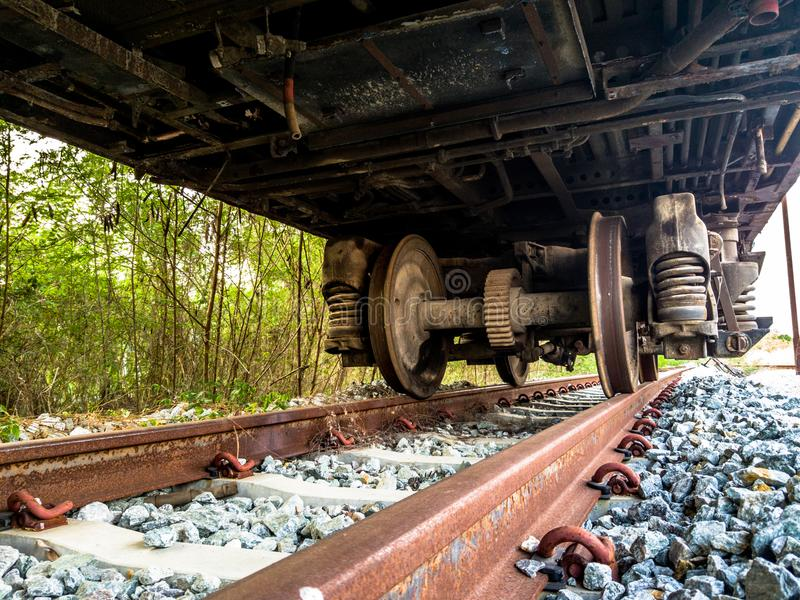 Old rusty wheel of retires train on the inactive rail track. At retires train station stock photos