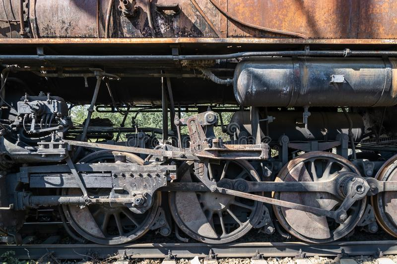 Old rusty wheels of the steam locomotive and the elements of the drive royalty free stock images