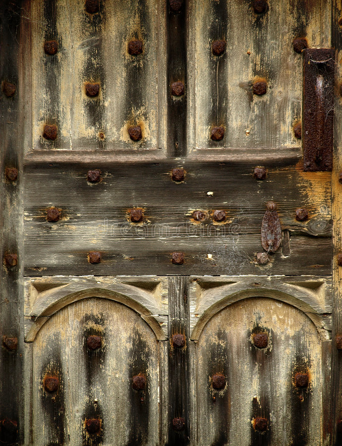 Free Old Rusty Wooden Gothic Door Detail Stock Images - 4517054