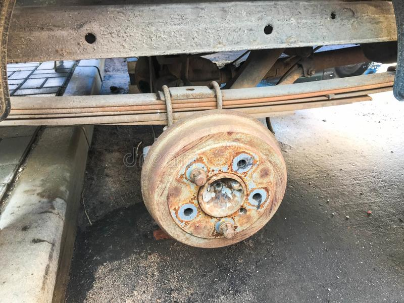 Old rusty worn drum brakes of a truck, car. Automotive suspension repair. Replacing wheel stock photography