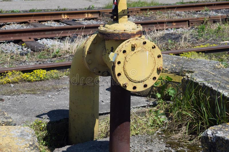 Old rusty yellow gas pipe. stock photos