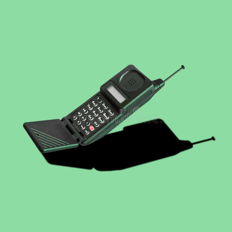 Old 90s classic analog mobile flip phone stock photography