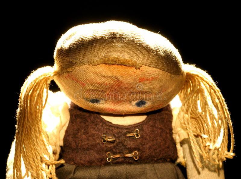 Old sad cloth doll with spot light #3 royalty free stock photography