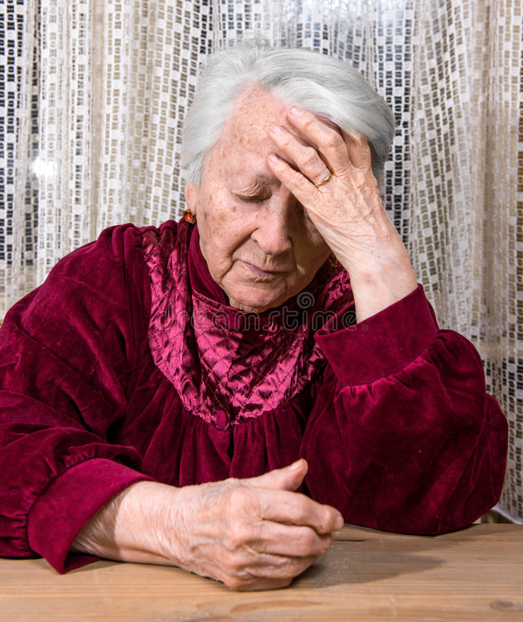 Old sad woman. Portrait of old sad woman at home royalty free stock photography