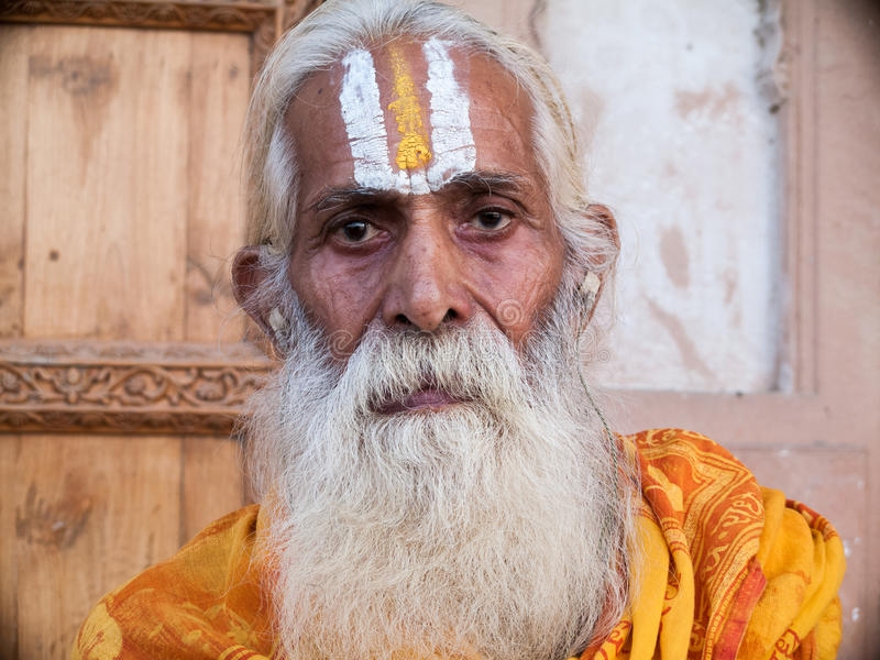 Old sadhu. VRINDAVAN, INDIA - OCT 10th - An old sadhu wearing tilak on his forehead, denoting his devotion to Krishna on October 10th 2009 royalty free stock photos