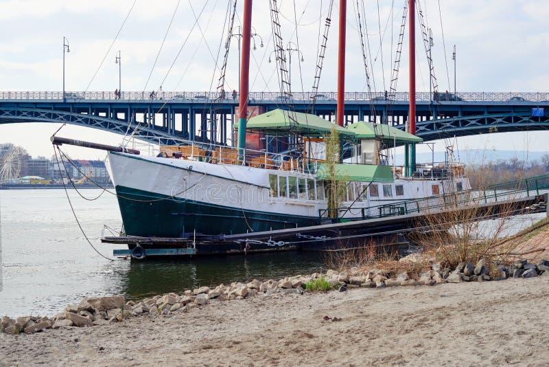 Old sail ship in front of a bridge near Mainz city stock photos