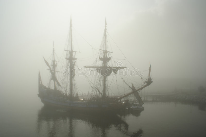 Old sail ship (Pirate?) in the fog royalty free stock images