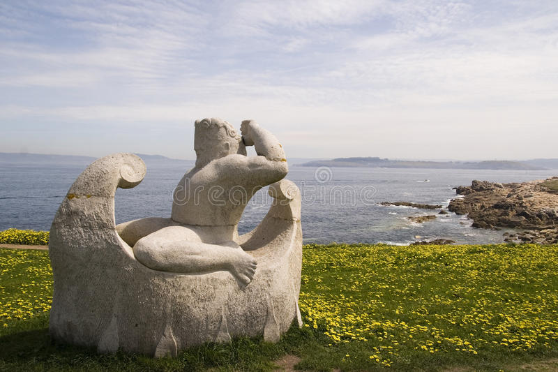 Old sailor sculpture and sea stock images