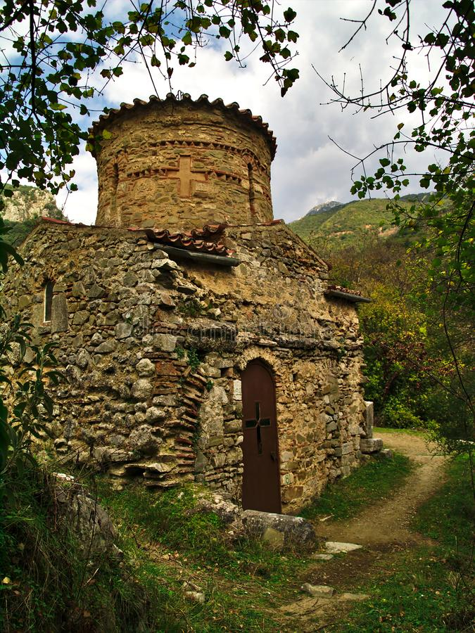 Old small orthodox christian stone church. Old Saint Andrew church on the banks of the Lousios River in Arcadia , Peloponnese Greece stock photo