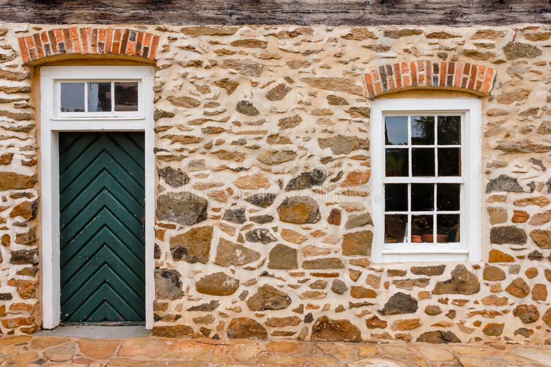 Door and Window on stone wall at Old Salem Museum and Gardens. & Old Salem Door and Window stock image. Image of pattern - 40704385