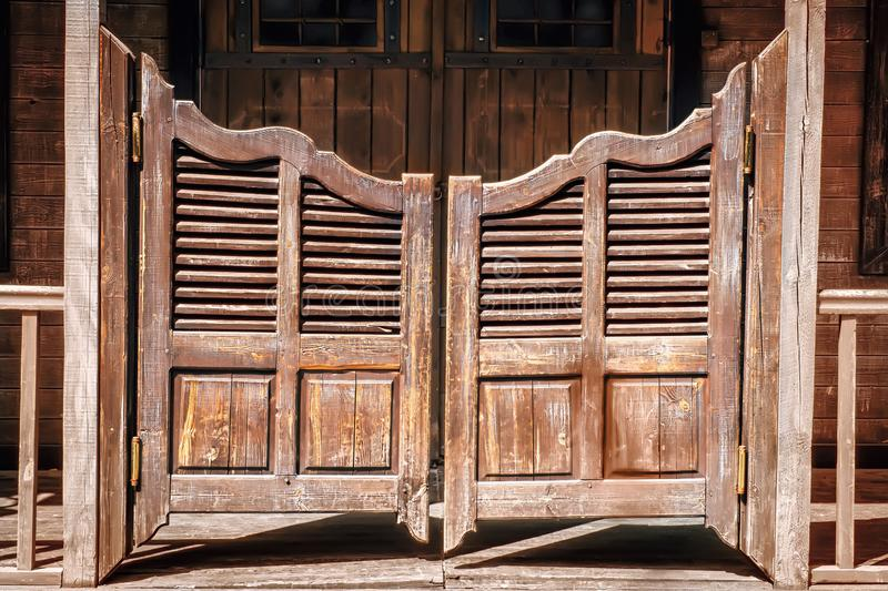 Old saloon entrance. With swinging doors royalty free stock images