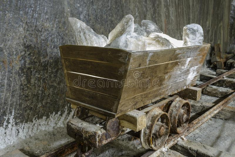 Old Salt Mine Cart. Out of use salt mine cart full of salt blocks, on its railway in gallery stock images