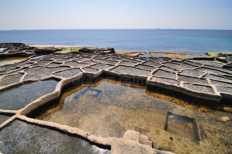 Old salt ponds. Old salt evaporation ponds, Malta island stock photo