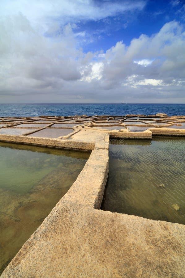 Old salt ponds. Old salt evaporation ponds, Gozo, Malta island stock images
