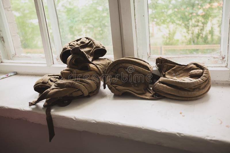 Old samples of headgear tankers lie on the window. royalty free stock photo
