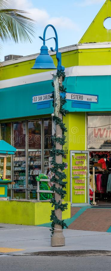 Old San Carlos Blvd & Estero Blvd sign post decorated for Christmas. In front of the Winds Family Beachwear store and shop royalty free stock photo
