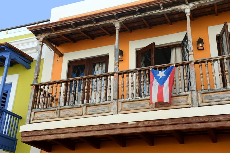 Old San Juan balcony in Puerto Rico. With flag hanging royalty free stock photography