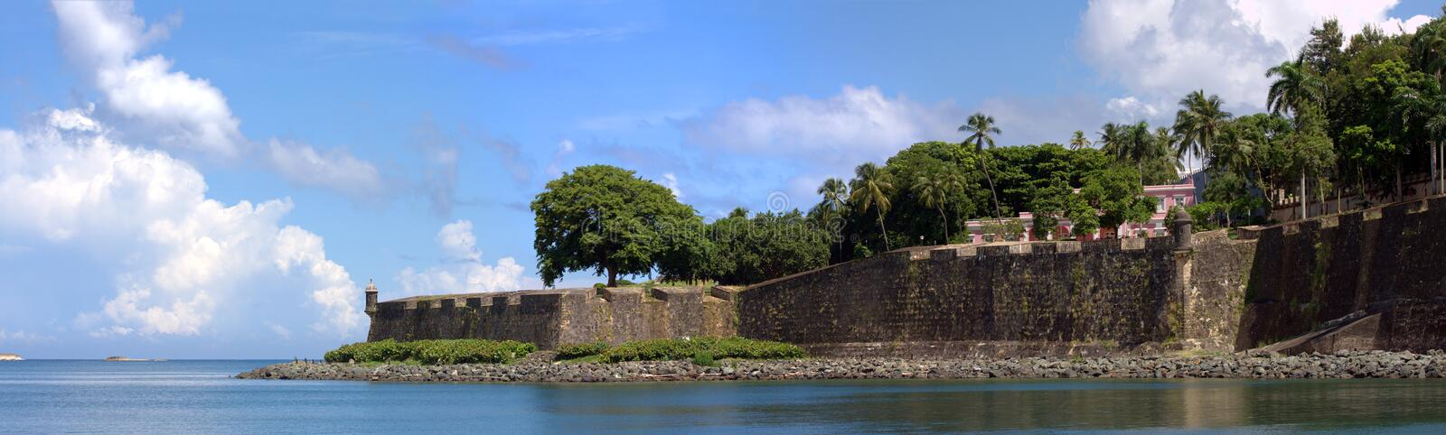 Old San Juan City Wall. The city boundary and old decaying wall of El Morro fort located in Old San Juan Puerto Rico royalty free stock images