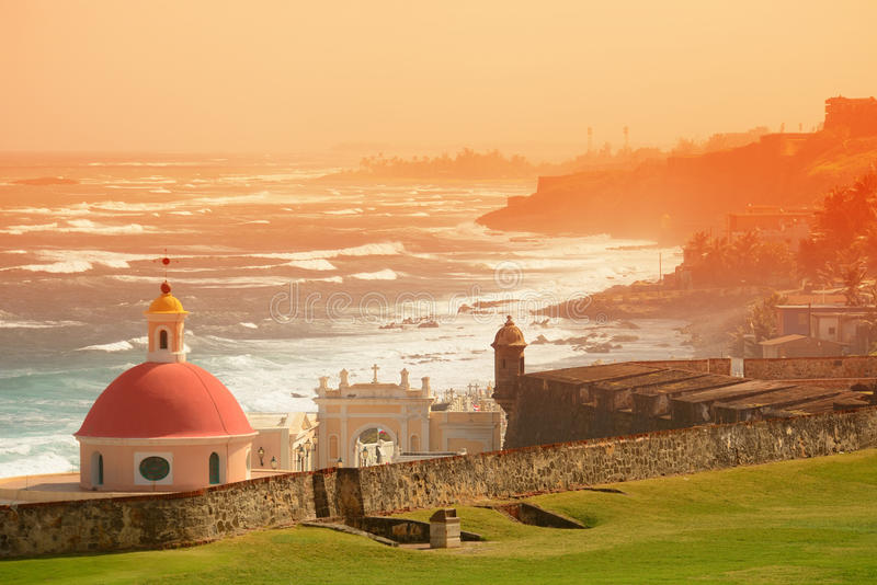 Old San Juan. Ocean view with buildings in red tone royalty free stock images