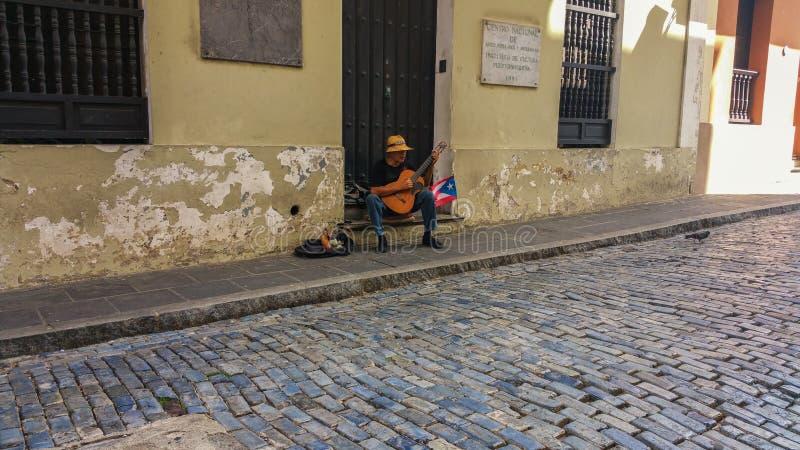 Old San Juan street guitarist. Music in the old san juan street royalty free stock photography