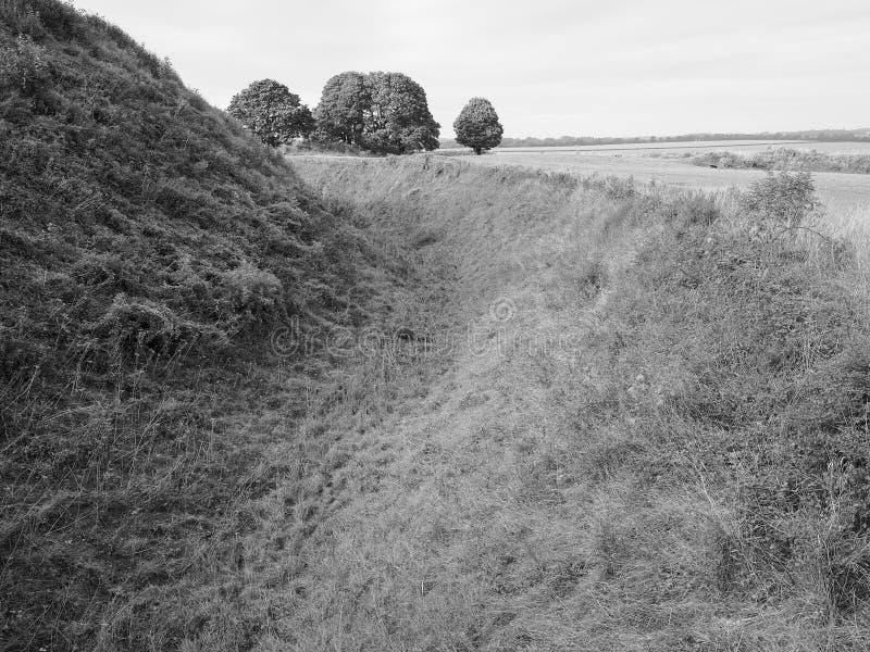 Old Sarum castle ditch in Salisbury in black and white. SALISBURY, UK - CIRCA SEPTEMBER 2016: Old Sarum castle ditch moat in black and white stock images