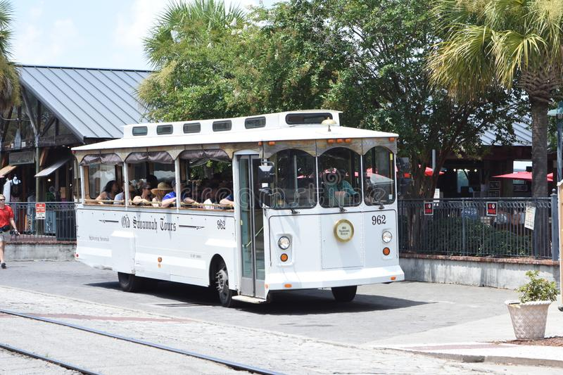 Old Savannah Tours Trolley on River Street stock image