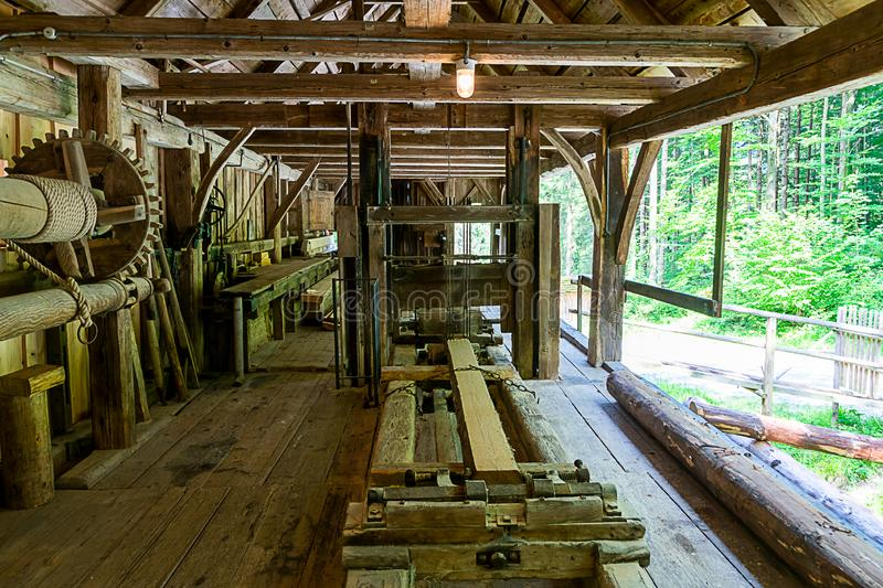An old sawmill. Here, like machines, they are still being moved by hydropower. The machines are powered by water stock photo