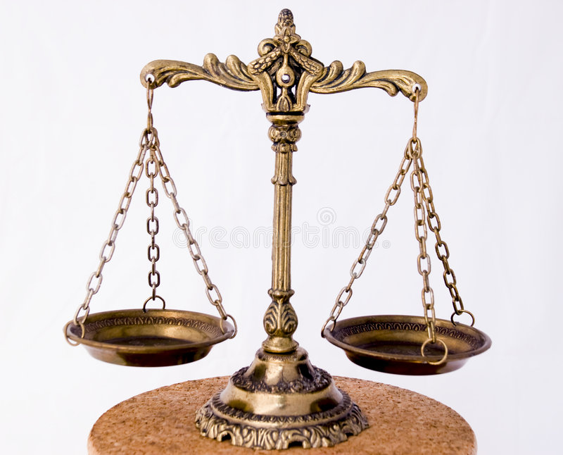 Old scales. A photo of the scales of justice with a balance theme overlay royalty free stock photos