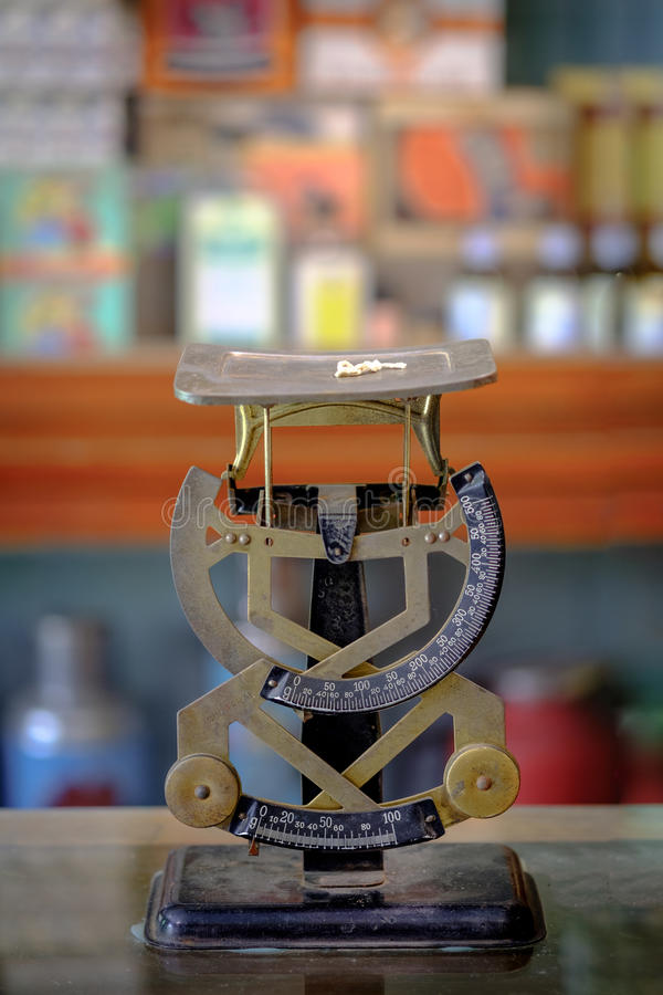 The old scales balance weight machine in vintage herb store. Ban stock images