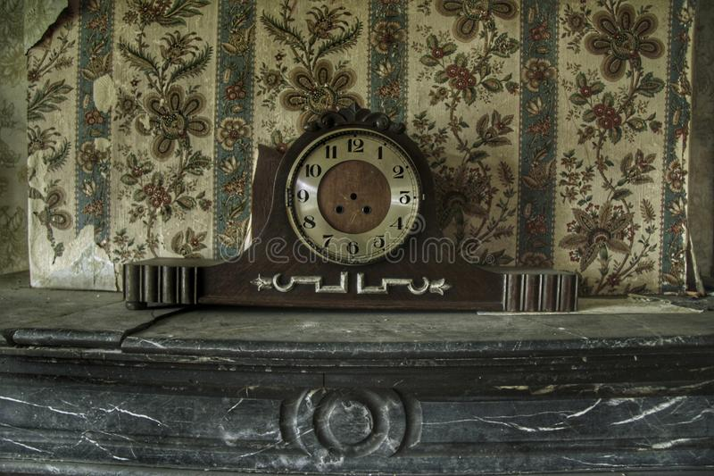 Old scary clock in an abandoned house stock images