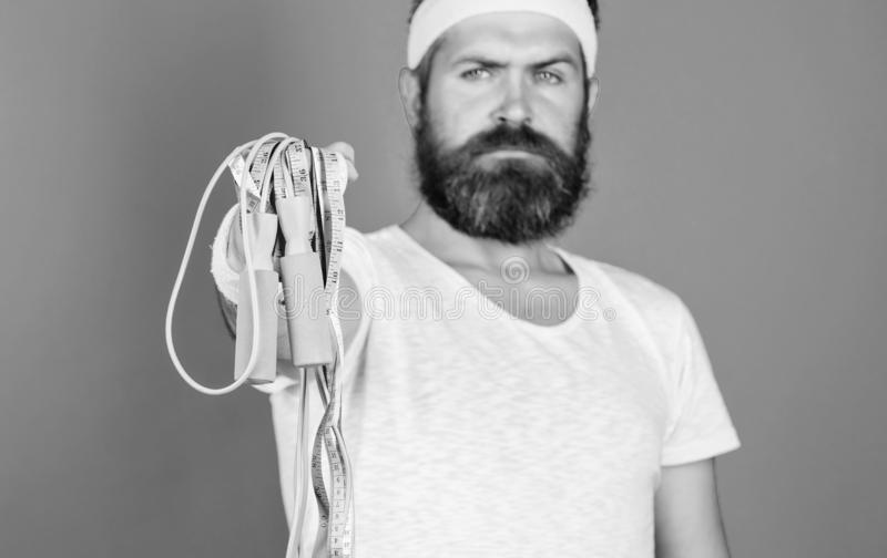 Old school aerobics concept. Athlete professional coach motivated for training. Athlete wear bandages for sweat. Man. Bearded athlete hold jump rope. You gonna royalty free stock images