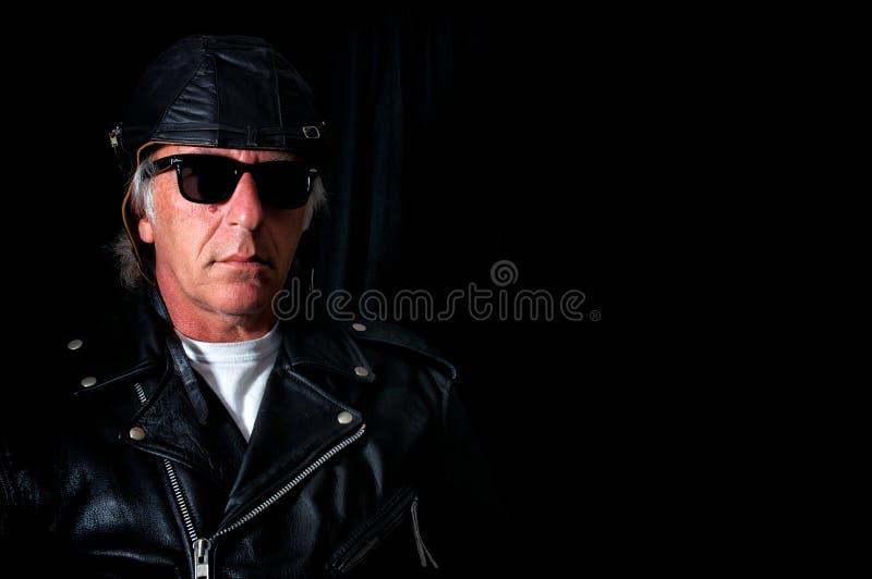 Old school biker on black royalty free stock photography