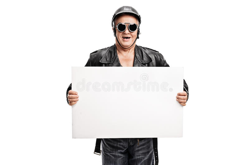 Old-school biker holding a white banner stock photography