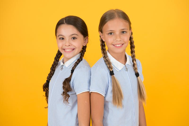 Old school fashion. back to school. happy beauty with pigtails. happy childhood. brunette and blond hair. sisterhood. Concept. best friends. vintage style stock photos