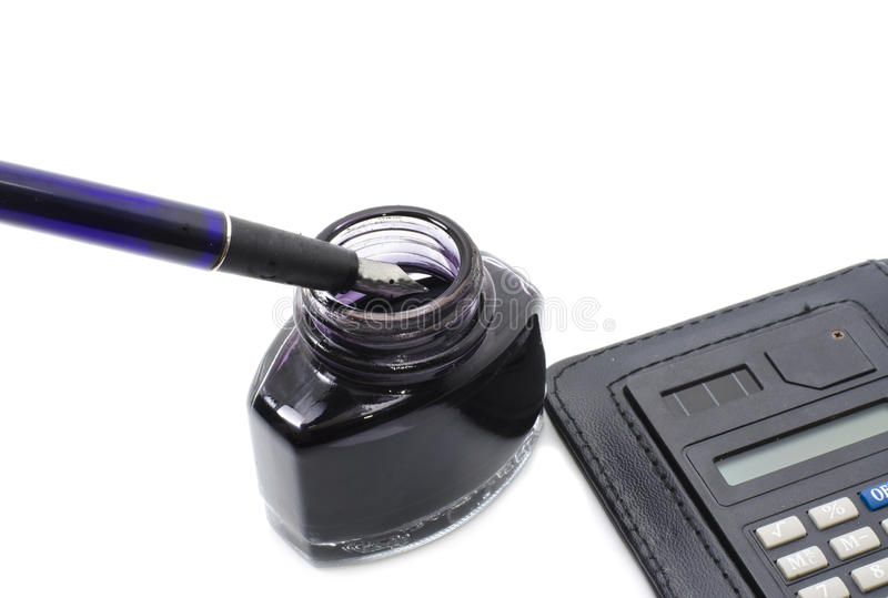 Old school pen with calculator and ink in the bottle royalty free stock photos