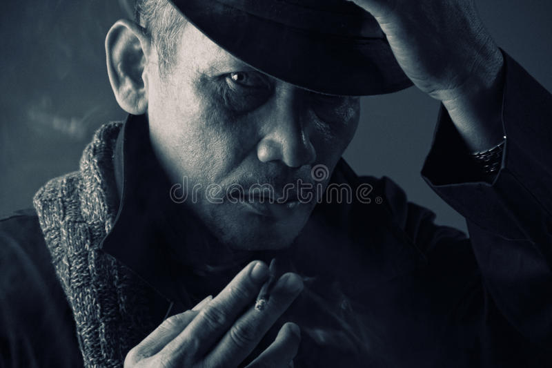 Old school style mafia. Vintage photo of an elderly gentleman dressed in old school style mafia stock images