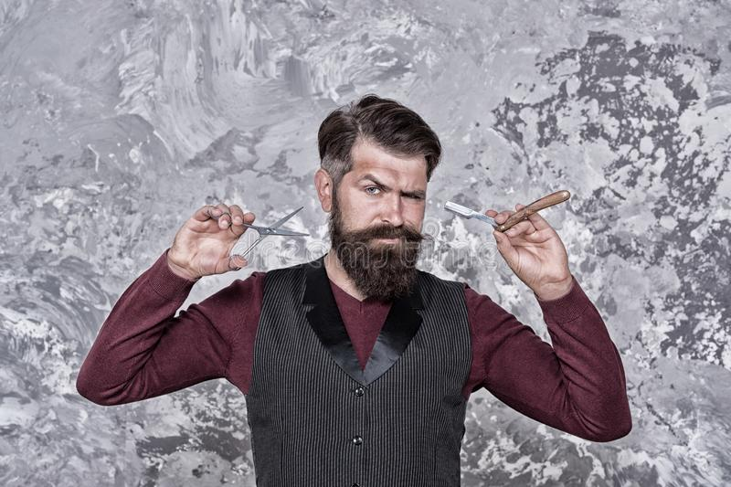 Old school and vintage. Facial hair care. Hiring barber. Barber equipment. Barber salon. Man bearded hipster with long royalty free stock images