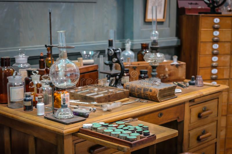 Old science lab with chemical reagents and burner.  royalty free stock photo