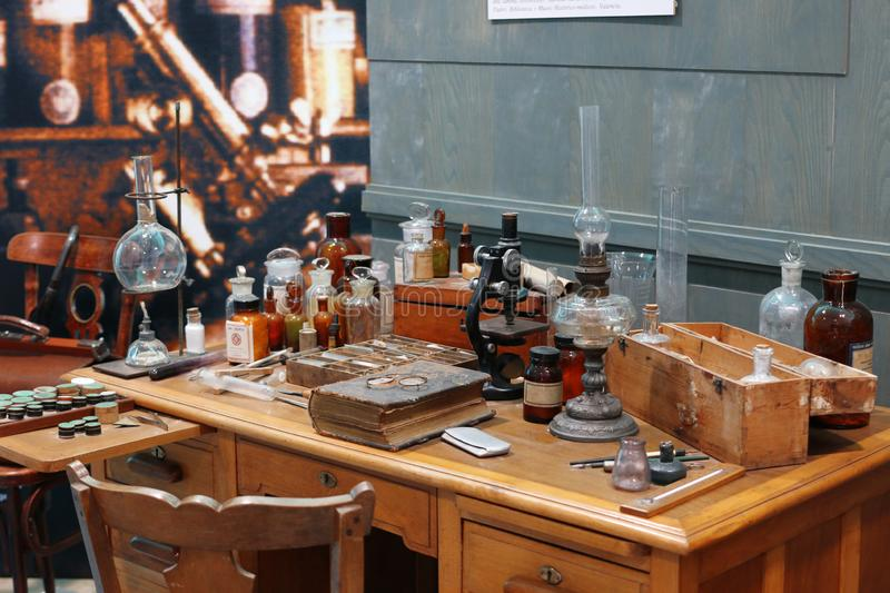 Old science lab with chemical reagents and burner.  royalty free stock photography