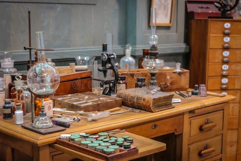 Old science lab with chemical reagents and burner.  stock image