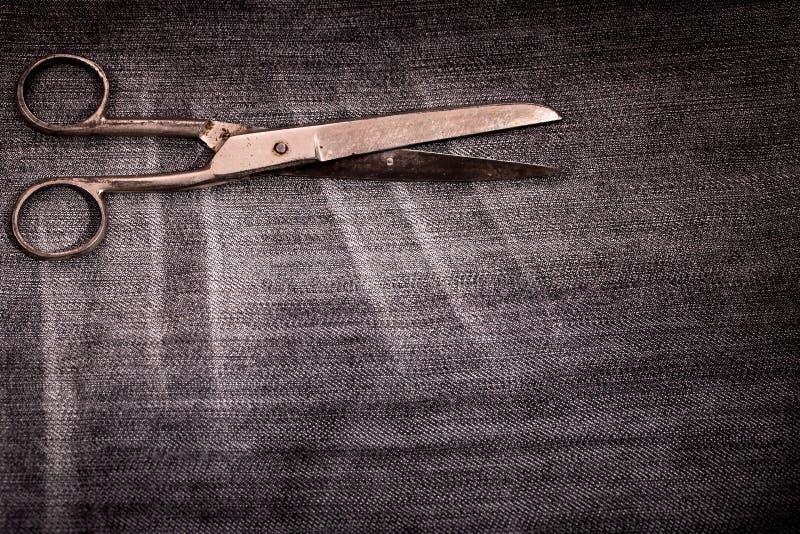 Old scissors on pincheck stock photos
