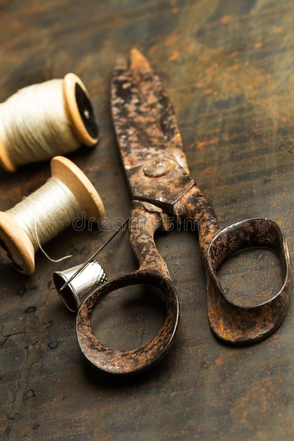 An old scissors with sewing threads royalty free stock photos