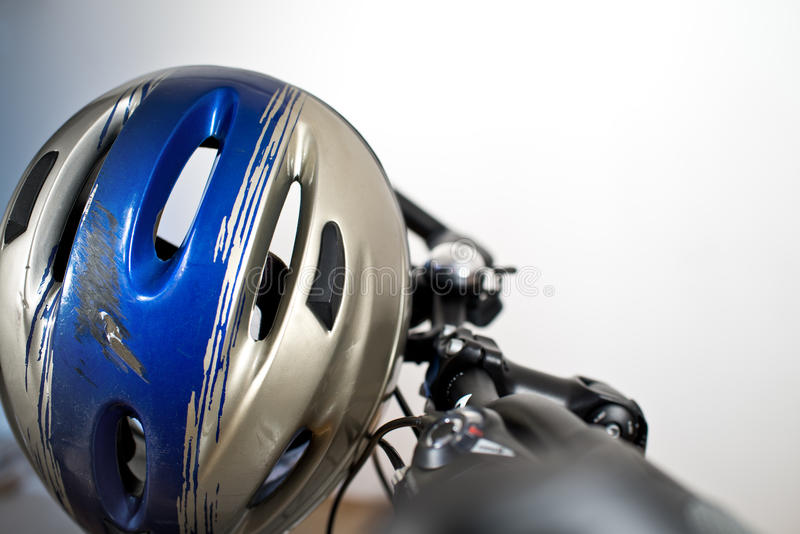Old Scraped Safety Helmet. On The Bike stock photography