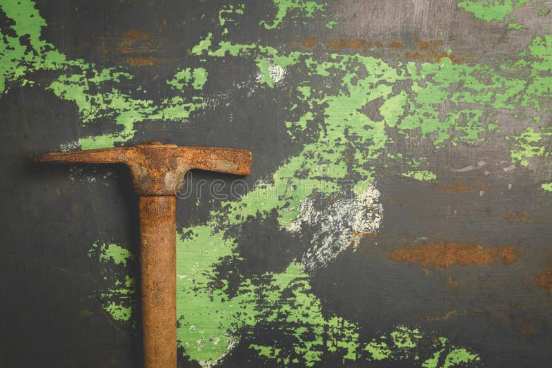 Old and scratched hammer on metal surface. Top view copy space, toned image royalty free stock photos