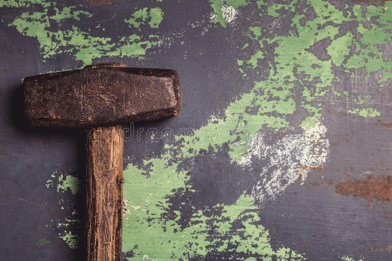 Old and scratched hammer on metal surface. Top view with copy space, toned image stock photos