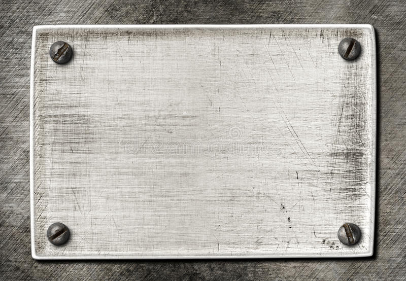 Old scratched metal texture with screws. Old scratched metal plate texture with screws royalty free stock images