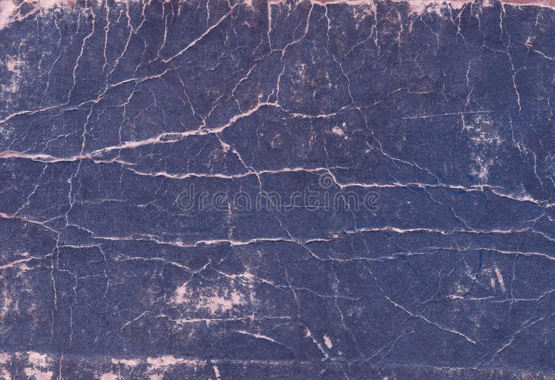 Old scratched and torn paper book cover surface. stock photos
