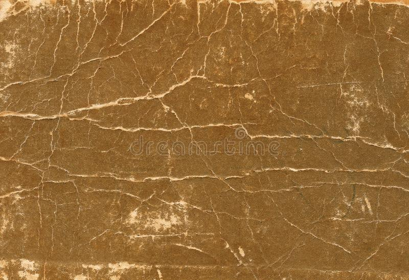 Old scratched and torn paper book cover surface. royalty free stock photos
