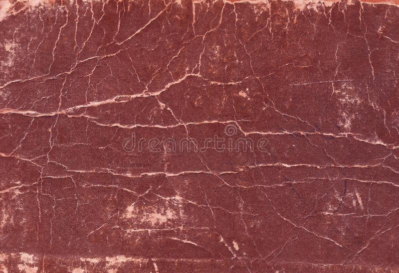 Old scratched and torn paper book cover surface. Abstract background and texture for design royalty free stock image