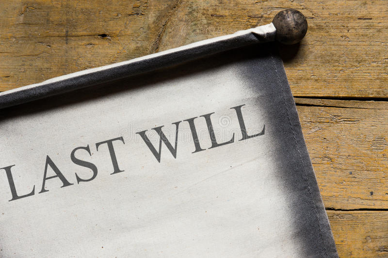 Old scroll on wooden table, last will. Written on the document stock images
